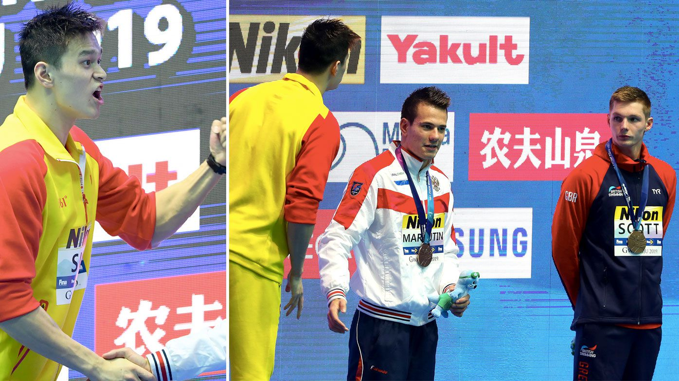 Sun Yang shirt-fronts Duncan Scott over second podium protest