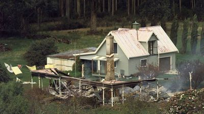 The remains at the Seascape Cottage continue to smolder Monday April 29, 1996 near Port Arthur, Australia. The cottage is where a gunman held several people hostage after going on a killing spree Sunday, killing at least 32 people.