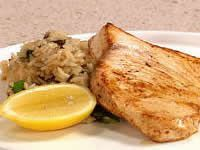 Swordfish with Raisin and Almond Rice