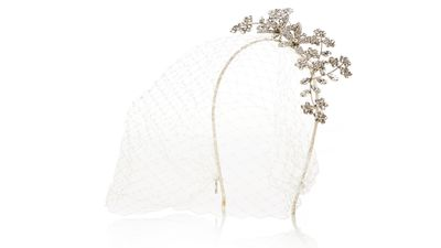 "<p><a href=""http://www.net-a-porter.com/product/542456/Jennifer_Behr/jasmina-violette-veiled-rhodium-plated-swarovski-crystal-headband"" target=""_blank"">Jasmina Violette veiled rhodium-plated Swarovski crystal headband, $1238.30, Jennifer Behr</a></p>"