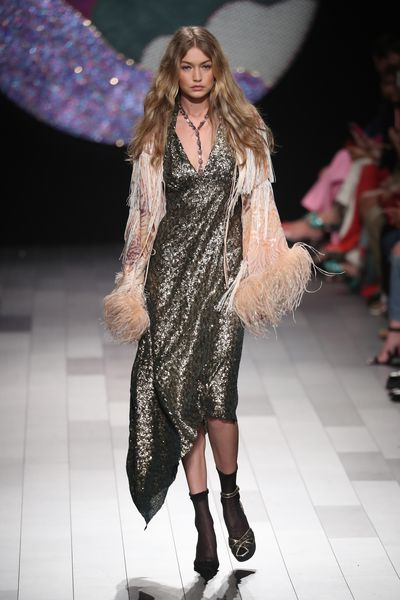 "<p>Wardrobe malfunctions are part of the business of being a model and Gigi Hadid treated her latest mishap as just another day at the office.</p> <p>At Anna Sui&rsquo;s spring 2018 show at New York Fashion Week Gigi found herself on the runway without a shoe.</p> <p>Somehow in the quick change into her second ensemble for the Age of Aquarius, hippie drippy show, Gigi failed to find her second show, not that the front row would have noticed.</p> <p>Perched on the balls of her feet Gigi managed to walk the length of the runway with only one stiletto on.<br /> For the finale Gigi returned to the runway with sister Bella by her side, offering a helping hand for the impromptu three-legged race.</p> <p>There were no hard feelings with Gigi recording a video message for Sui, who is celebrating her thirtieth year as a designer. </p> <p>""I just want to say thank you so much for having me in your show,"" Gigi said.</p> <p>""You&rsquo;re like family to me. I appreciate your support from the very beginning so much, and I always love being a part of your show.""</p>"