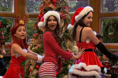 We have a feeling Ariana Grande (far left) wouldn't mind burning some of the Christmas snaps from past holidays on the set of her old Nickelodeon series <i>Victorious</i>.