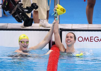 Emma McKeon is congratulated by teammate Cate Campbell after winning gold medal in the Women's 100m Freestyle Final photo.