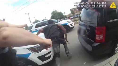 In the police bodycam vision, Augustus can be seen flailing away from police before his shirt is raised. Picture: CNN.