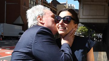Michael Cranston embraces his wife Gloria after being found not guilty at the Downing Centre Courts in Sydney on Friday.