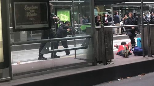 At least six police officers were seen arresting a man at gunpoint in Melbourne'S CBD today. Picture: Supplied.