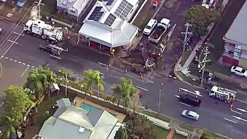 Residents of a suburban Brisbane street have told of how they awoke to their homes and backyards being flooded after a burst water main caused a sinkhole this morning