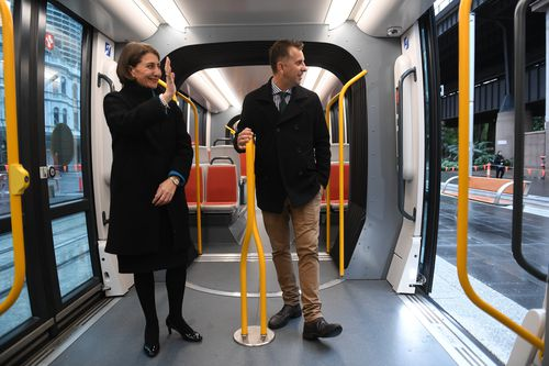 Premier Gladys Berejiklian and Minister for Transport Andrew Constance ride on the first light rail vehicle test from Town Hall to Circular Quay in Sydney.
