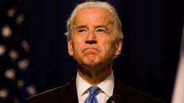 Joe Biden gestures during a speech