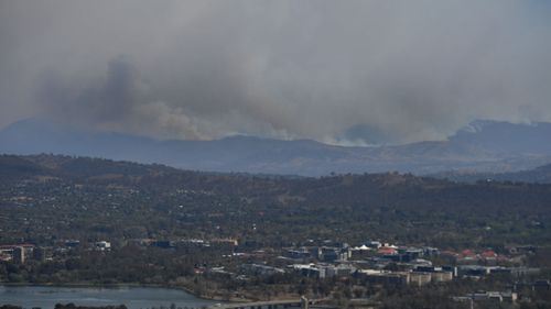 A bushfire burning south near the town of Tharwa, 30km south of Canberra