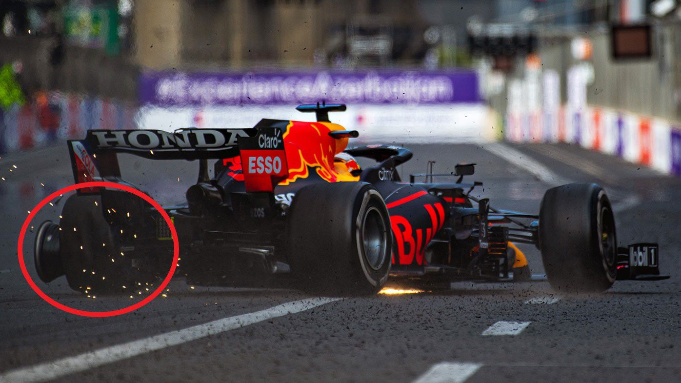 Max Verstappen is sent towards the wall as his left-rear tyre fails.