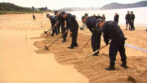 NSW Police are scouring the sand at Umina Beach for evidence.