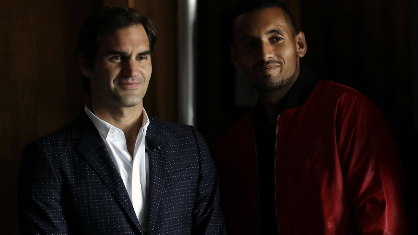 Roger Federer, left, and Nick Kyrgios watch a highlight video from the 2017 Laver Cup during a promotional news conference for the tournament Monday, March 19, 2018, in Chicago