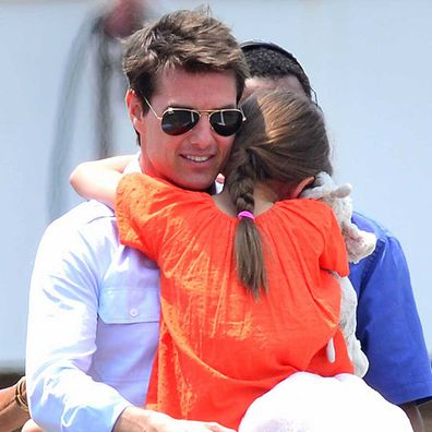 Tom Cruise and Suri Cruise leave Manhattan by helicopter at the West Side Heliport on July 18, 2012.