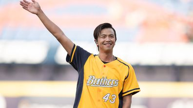 Singer Alien Huang (Hung Sheng Huang) performs prior to the CPBL game between Rakuten Monkeys and CTBC Brothers at the Taichung Intercontinental Baseball Stadium on August 09, 2020 in Taichung, Taiwan