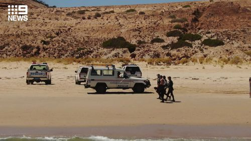 Police searching the South Australian beach after two bones were found.