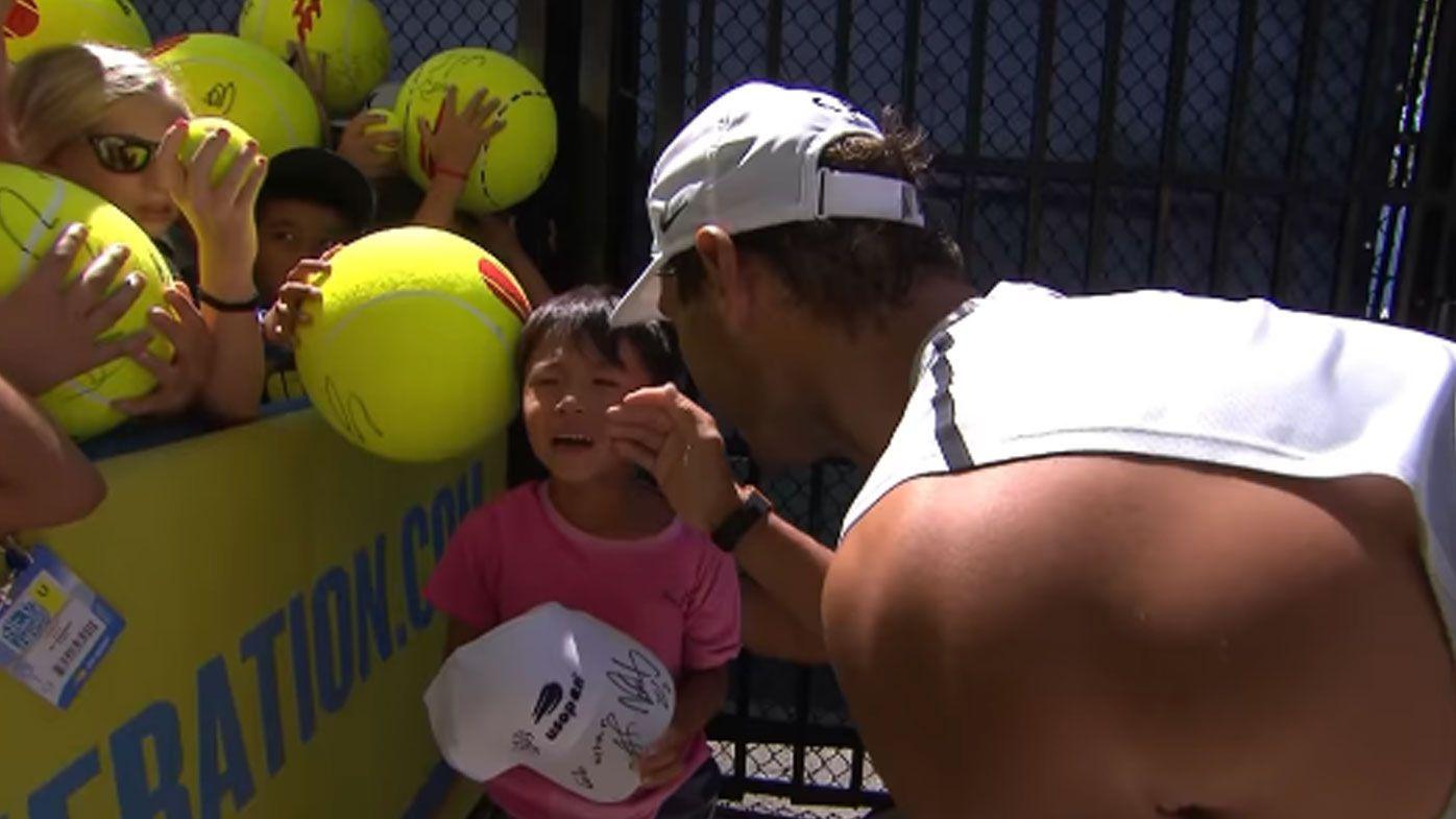 Rafael Nadal comforts a young fan