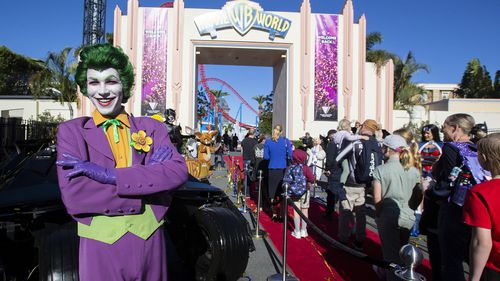 A performer welcomes guests at Warner Bros. Movie World on July 15, 2020 in Gold Coast, Australia. Movie World has reopened to the public with extra safety and hygiene measures in place following its temporary closure on 23 March 2020 due to the COVID-19 pandemic.
