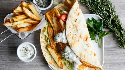 """Recipe:<a href=""""http://kitchen.nine.com.au/2017/05/17/11/06/grilled-haloumi-pita-gyros-with-tzatziki-and-oven-baked-herb-salted-fries"""" target=""""_top"""" draggable=""""false"""">Grilled haloumi gyros with tzatziki and oven-baked herb salted fries</a>"""