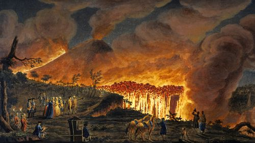 Hand-coloured etching by Peter Fabris (active 1768-1779) shows lava streams running into the valley between Mount Somma and Vesuvius. These streams formed a cascade of fire around 50 metres in height as they headed toward the town of Resina, near Naples. (Getty)