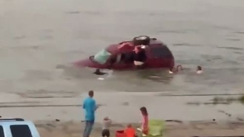 Harley Day rescuing his daughters from a sinking car.