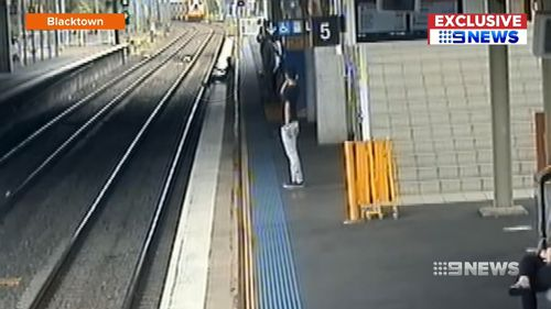 In Blacktown, it was a deliberate game of chicken as a person seen on CCTV footage sees a train coming but sits down anyway. Picture: Supplied
