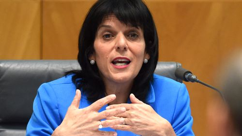 Julia Banks speaks to ANZ CEO Shayne Elliott during the House of Representatives Standing Committee on Economics annual public hearing at Parliament House.
