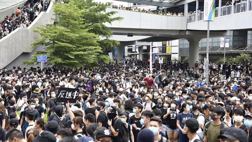Tens of thousands of protesters against China's extradition law, a bill to extradite prisoners to mainland China occupy a road and street to the Legislative Council, in Hong Kong.