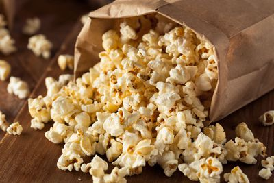 For air-popped popcorn (387 calories/100g)