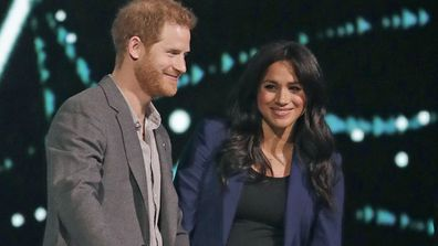 Prince Harry joined by Meghan on stage at the end of his speech at WE Day UK in March 6, 2019.