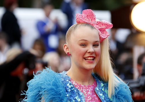 The 15-year-old brought her signature style- and hair bow- to the Logies red carpet on Sunday. (AAP)
