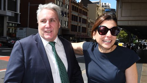 Cranston and his wife joyous outside court this morning.