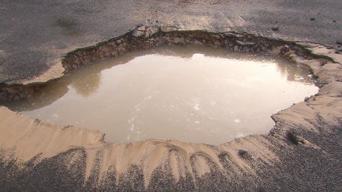 It's believed a burst water main caused the hole to form.