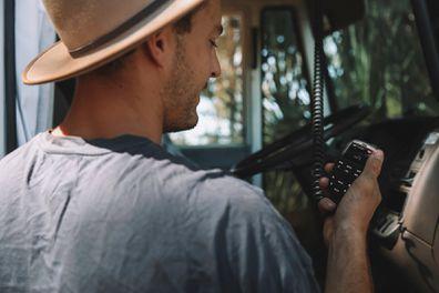 Harry Vick, van life influencer, using an emergency GME communication device / handheld radio