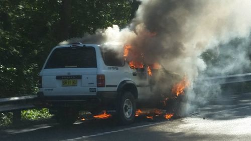 Driver walks free after car bursts into flames on NSW Central Coast