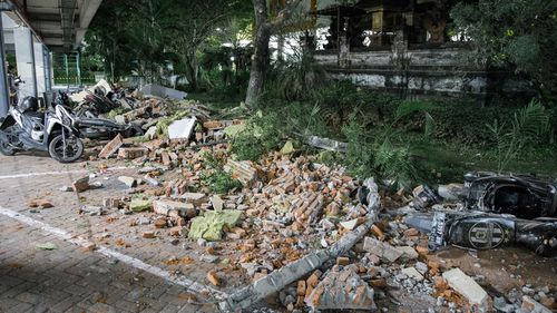 Debris in Bali from collapsed buildings and the Lombok earthquake