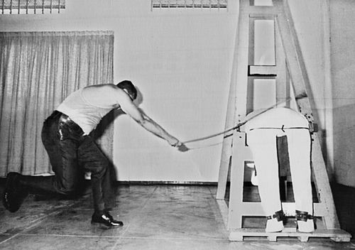 A caning officer demonstrates on a device which is used to cane criminals in Singapore.