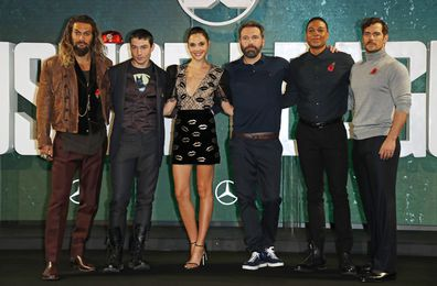 Justice League cast attend photocall at The College on November 4, 2017 in London, England.