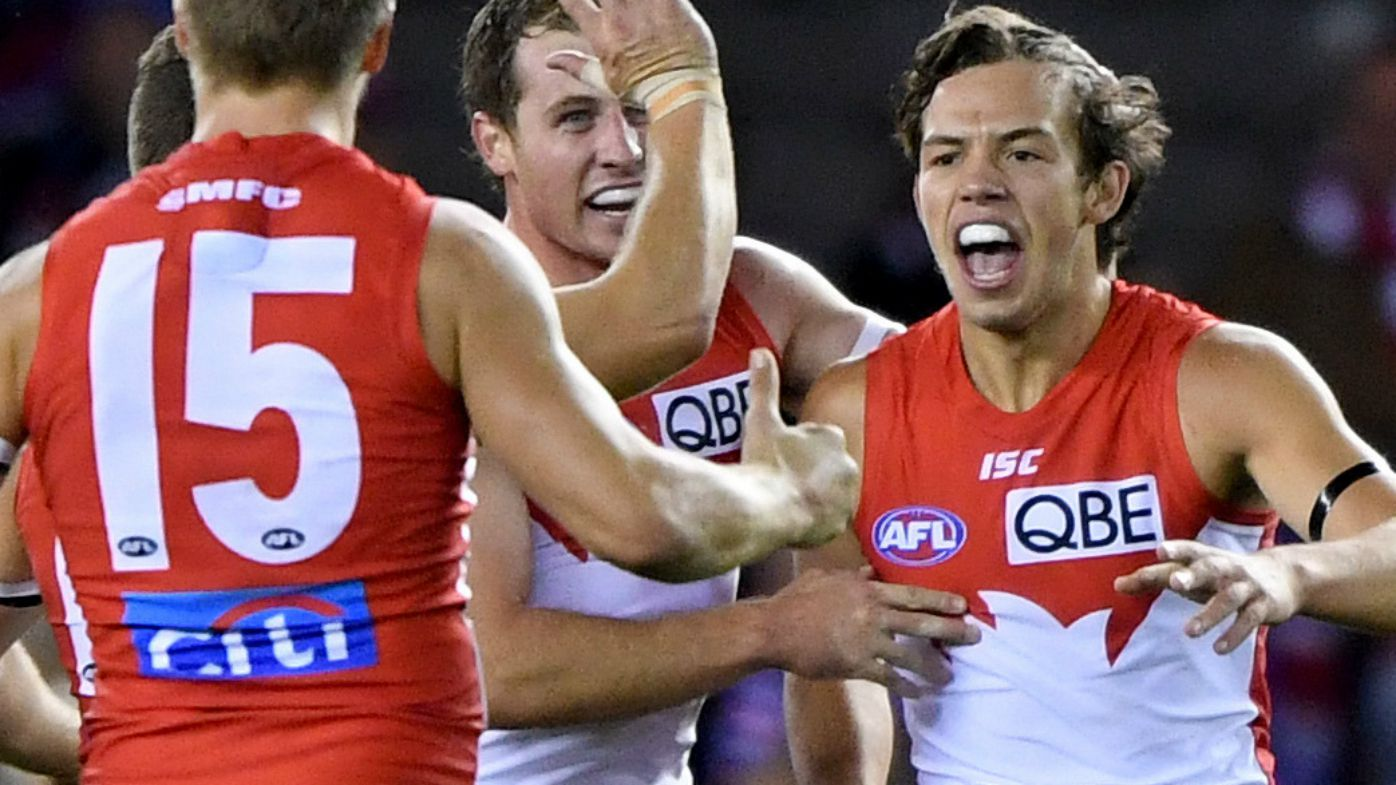 Sydney Swans hold on in a thriller over Western Bulldogs in Etihad Stadium classic