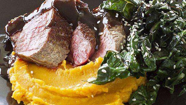 Beef fillet with orange miso sauce, sesame kale and sweet potato mash