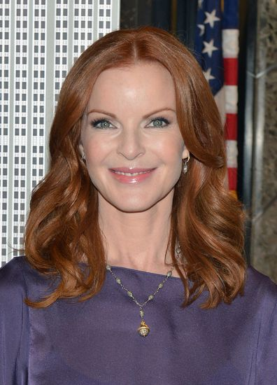 Actress Marcia Cross visits The Empire State Building in honor of first annual International Day of the Girl, on October 10, 2012 in New York City.