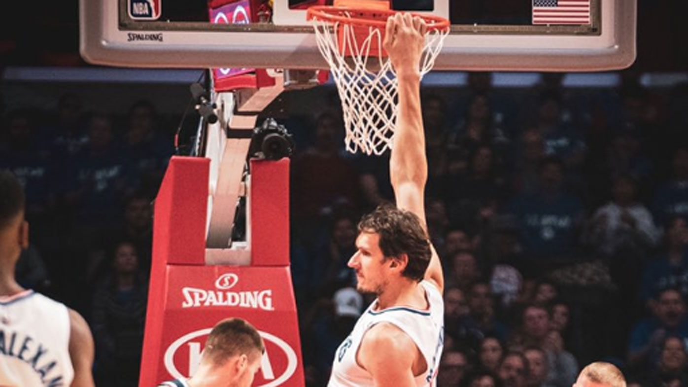 National Basketball Association giant Boban Marjanovic breaks rim with ridiculous no jump dunk