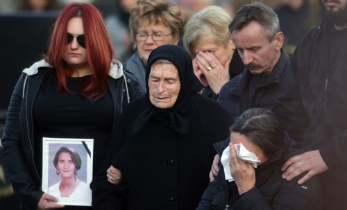 Mourners at Ms Dominic's funeral.