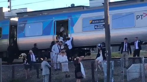 The hot, crowded trains left some racegoers with no choice but to push open the train doors. (Sean Davidson)