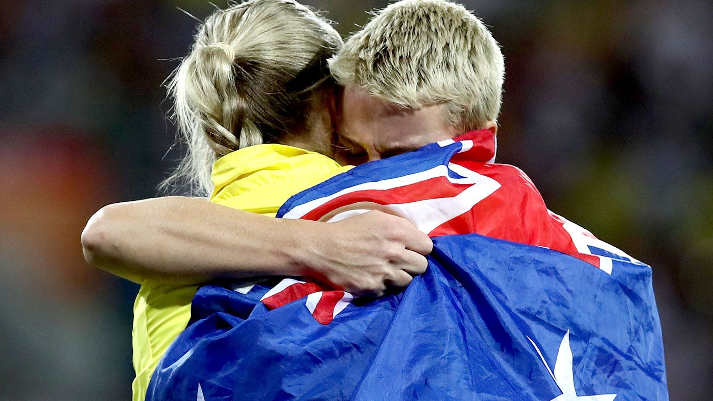 Kathryn Mitchell is congratulated as she wins gold by silver medalist Kelsey-Lee Roberts in the Women's Javelin final. (Getty)