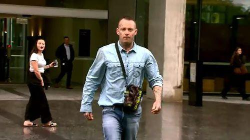 Man hurls abuse at camera crews outside court