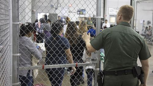 An undated photo showing people inside a United States Border Patrol Processing Center, in McAllen, Texas, USA. (AP)