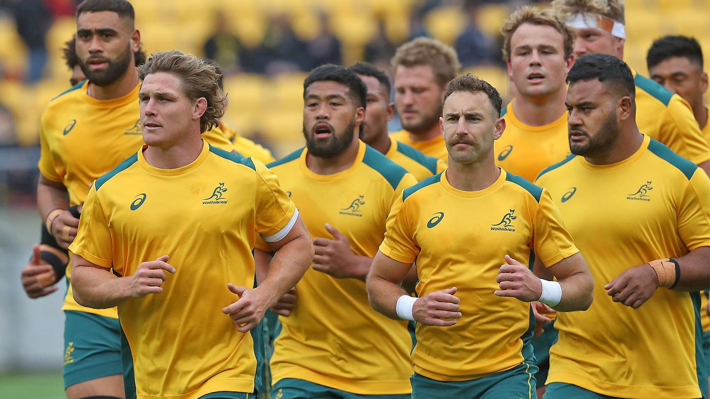 Michael Hooper of the Wallabies leads the team back