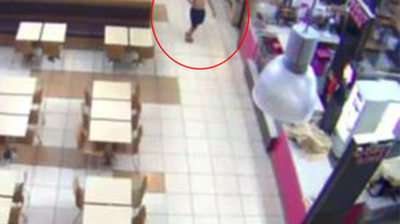CCTV of shirtless sweet toothed-crim gorging in closed Melbourne food court.
