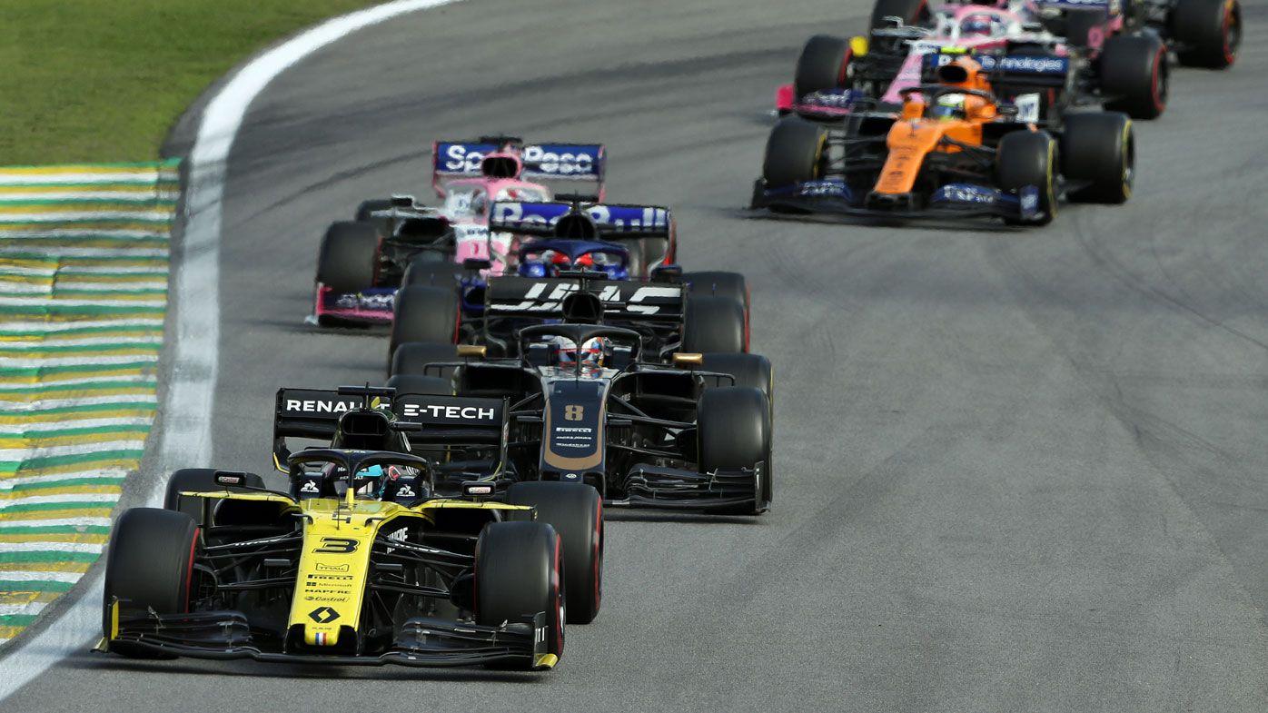 Daniel Ricciardo of Australia driving the (3) Renault Sport Formula One Team RS19 leads Romain Grosjean of France driving the (8) Haas F1 Team VF-19 Ferrari on track during the F1 Grand Prix of Brazil